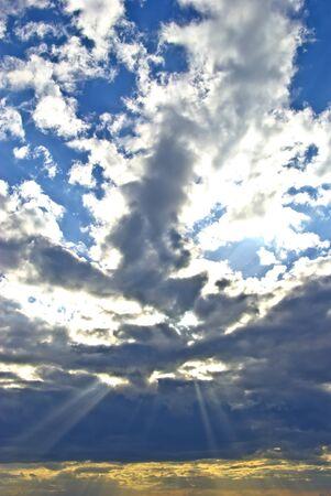 suns: Suns rays breaking through the dark rain clouds