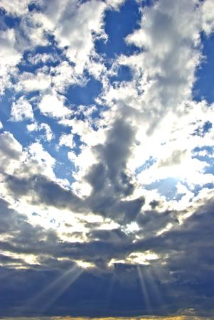 suns: The suns rays breaking through the dark rain clouds
