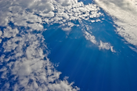 Sunlight among the clouds in the blue sky.