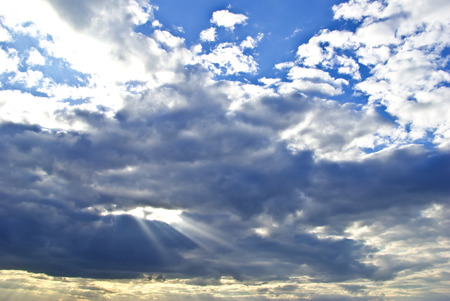 The suns rays breaking through the dark rain clouds