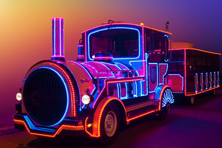 Fabulous, magical locomotive glow in the dark colored lights Stock Photo