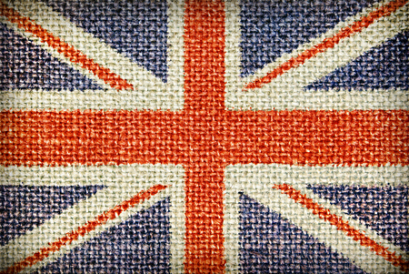 char: Texture of coarse cloth with the image of the Union Jack. Stock Photo