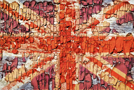 Texture of old paint, crackles with the image of the Union Jack. Stock Photo