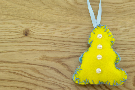 Homemade cloth toy mascot on a wooden background
