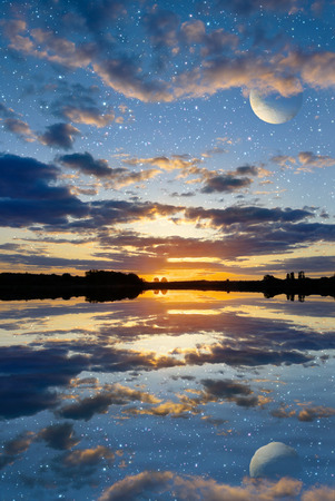 Sunset over the lake on a sky background with planets Elements of this image furnished by NASA