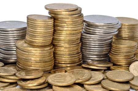 Folded stack of coins of yellow and white metal Stock Photo