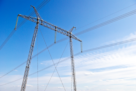 electricity export: High-voltage line on the background of blue sky .