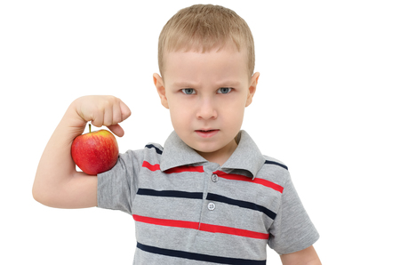 strong boy: Strong boy with apple isolated on white background