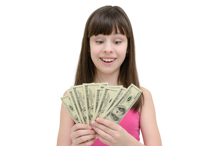 cupidity: Girl in amazement holding money on white background