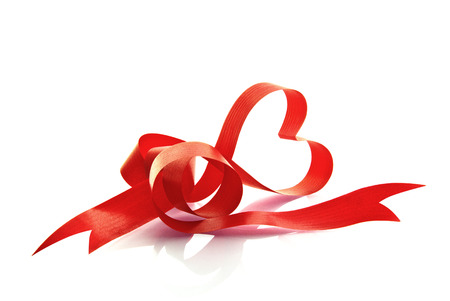 The red ribbon in the form of the heart. Stock Photo