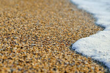 Tidal wave on a clean, sandy, sea beach Stock Photo