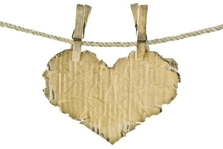 clothespegs: The cardboard heart on a clothesline.