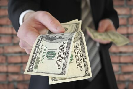subornation: A man in a business suit offers money