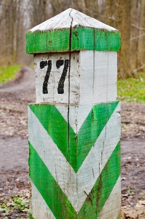 demarcation: Old, wooden, demarcation, border sign, set in the woods
