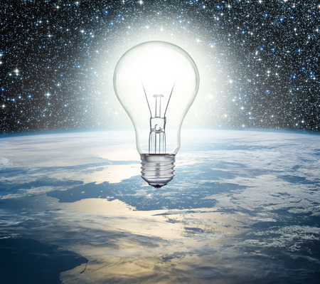 irradiation: Light bulb over Earth on a background of the universe