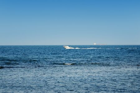 motor launch: Motor boat in sea on a background of blue sky