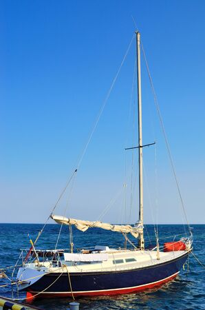 motor launch: Yacht in the dock on a background of blue sea