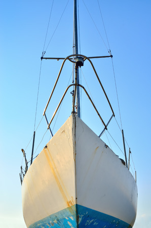 shipway: Old, rusty boat on the background of blue sky