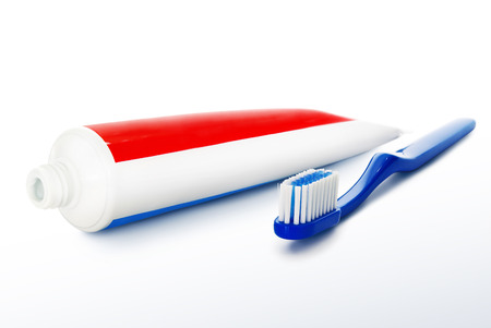 Toothbrush and toothpaste isolated on a white background.