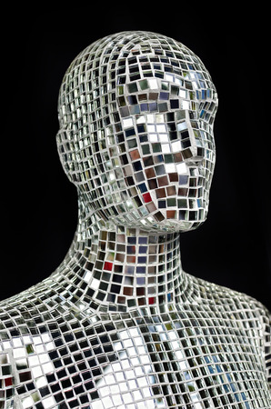 Silhouette of human body from sparkling mirror pieces