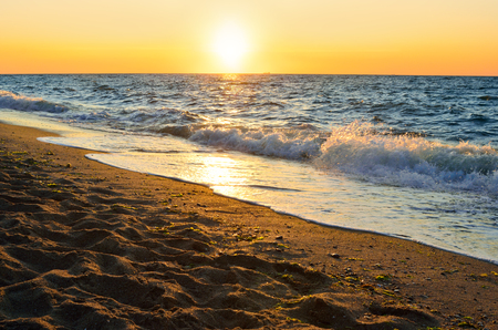 eventide: Seacoast on a background of the rising sun Stock Photo