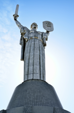 Monument Rodina Mother on the background of the blue sky. Communist symbol of the totalitarian Soviet regime in Kiev, Ukraine.