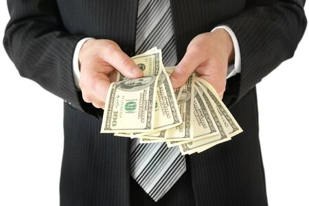 subornation: Man in black business suit, holding cash in hands.