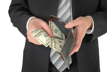billfold: Man in black business suit, holding cash in hands.