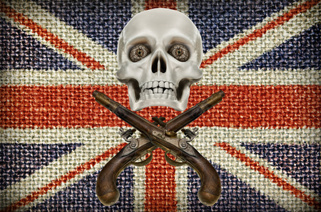 dueling pistol: Pirates coat of arms Jolly Roger, in background of the Union Jack