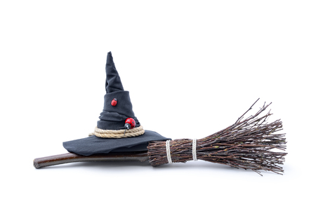 Magic Broom and Witch Hat on a White Background