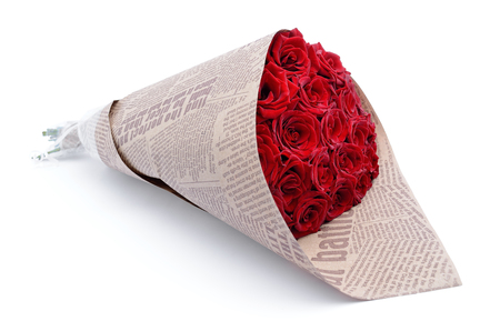Bouquet of red roses wrapped in newspaper on white background Stock Photo