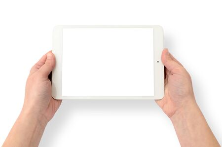 Hands holding a gadget on a white background. Tablet computer, wireless device.