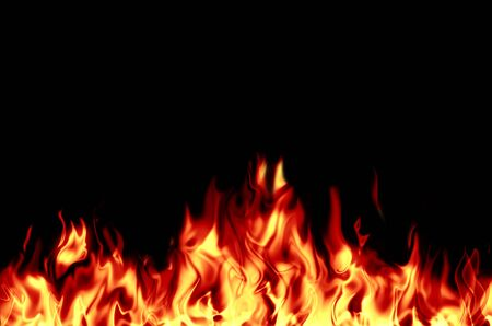Bright, burning flame on a black background. Fire and center of ignition. Stock Photo