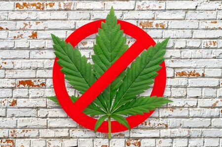 Stop narcotic sign on a brick wall background. Stock Photo