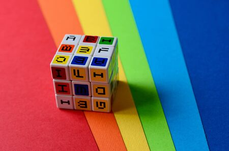 Puzzle with the alphabet on colorful sheets of paper.