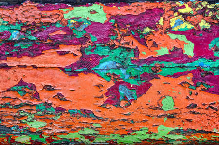 Texture of old, cracked, colorful paint on wood Imagens