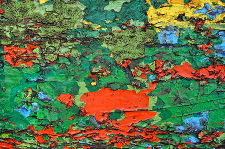 Texture of old, cracked, colorful paint on wood 免版税图像