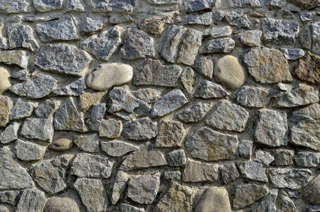 Texture of a wall built of granite stones 免版税图像
