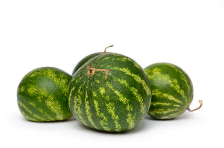 Ripe, green watermelons isolated on white background