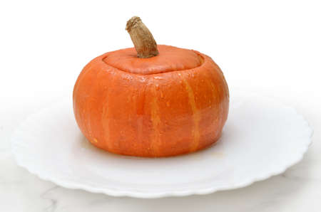 Dessert, baked pumpkin on a white dish