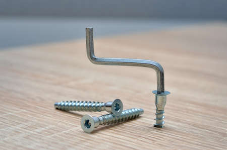 Furniture assembly tools on a wooden background