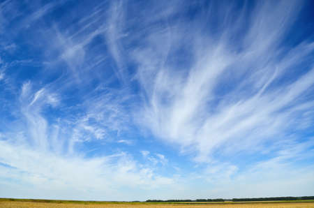 Blue sky, light clouds, Earth horizon panorama 免版税图像
