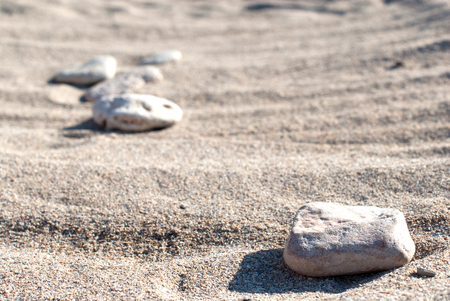 Sand with rock in focus and more out of focus. Stock Photo