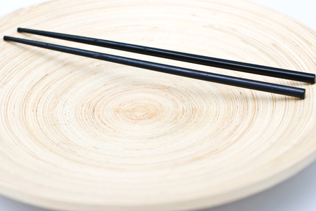chinese stick on wooden plate Stock Photo