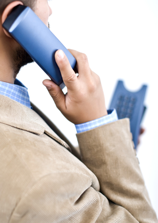 doing business: manager doing business at office, makeing phone calls during work Stock Photo