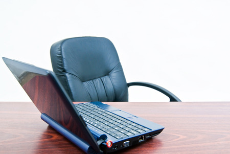 Office desk with free chair and laptop, job seeking, job searching