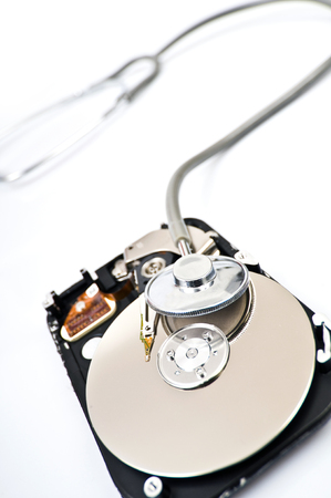 harddisc: Opened hard drive with stethoscope on top, checking your data, verifying your information, scan for viruses your computer Stock Photo