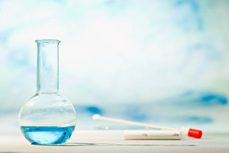 Chemistry lab with flask filled with blue liquid.
