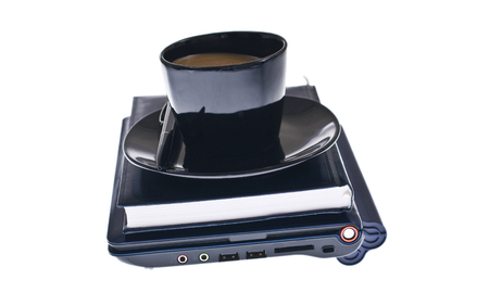 Laptop, agenda and on top of them a coffee cup, business pack, office tools. Stock Photo
