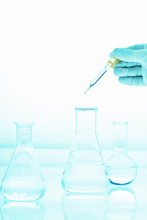 Hand holding eprubeth with flask on white bacground, medical research, laboratory research Stock Photo